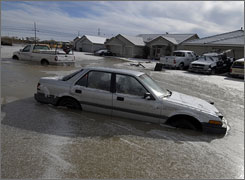 Flooded cars sit in icy water in Fallon, Nevada, on Sunday.