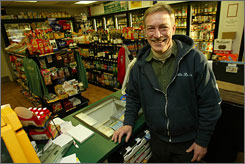 """Kevin Duval, assistant manager of Little Roy's convenience store in Peterborough, N.H., says he will likely vote for Democrat Barack Obama in the upcoming presidential primary, even though he voted for Bush in 2004. Duval and others have New Hampshire politics turning """"purple."""""""