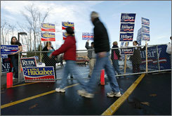 Residents cast their ballots in at the Londonderry (N.H.) High School on Tuesday. Unlike other states, independents can vote in either primary in the New Hampshire.