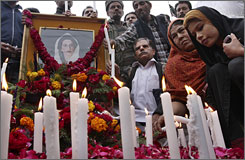 Supporters of Pakistan's slain opposition leader Benazir Bhutto light candles in Karachi.