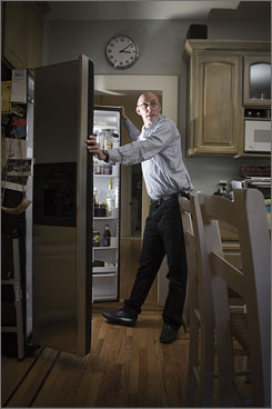 Author Michael Pollan, 52, peruses the refrigerator in the kitchen of his Berkeley, Calif., home. He recommends clearing your home of any food your great-grandmother wouldn't recognize.