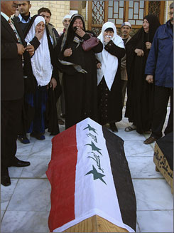 Women cry near the coffin of a relative killed in a bomb attack, during a funeral in Baghdad's Adhamiya district on Monday. Two suicide bombers struck the district, killing at least 14 people including the leader of the area's neighbourhood patrols, police said. Since many deaths go unreported in Iraq, the war's true toll on civilians may never be known.