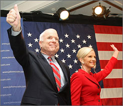 Republican presidential candidate Sen. John McCain and his wife Cindy acknowledge supporters at his primary night victory rally in Nashua, N.H., Tuesday.