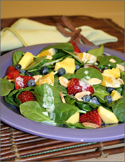 This fresh fruit and spinach salad, put together by the Pennsylvania State University Food Lab, could help women consume 12% fewer calories if eaten before a meal.