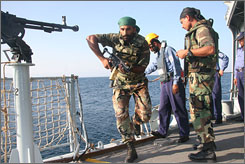 A Pakistani soldier boards the Pakistani warship PNS Babur during maneuvers last November in the Arabian Sea. Following a rash of pirate attacks off the Somali coast, an international coalition headed by a U.S. admiral came up with a new strategy late last year to target the elusive pirate motherships.