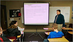 Joel Chaky teaches a world history class for the Chilhowee School District in Chilhowee, Mo., Tuesday. To provide for his family, Chaky works in a restaurant a few nights a week to supplement his insufficient salary.