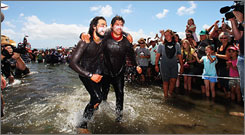 , and Justin Jones step ashore on Ngamotu beach in New Plymouth, New ...