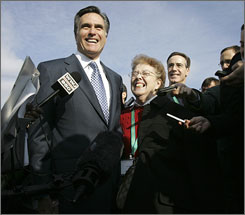 Republican presidential hopeful former Massachusetts governor Mitt Romney, left, and his first grade teacher Gloria Blazo talk to reporters in Livonia, Mich.