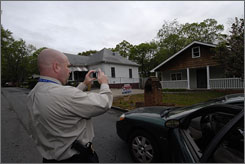 Atlanta Police Detective Robert McFall investigates mortgage fraud in the city. He takes a photo of a home as part of his investigations.