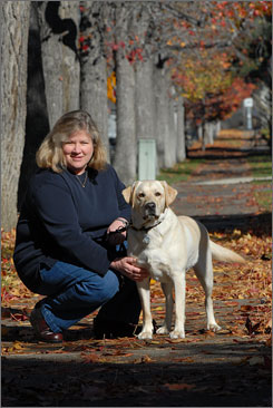 Economist Kerry Odell gets her meditative time in when she walks her dog, Finn, at the Scripps College campus in Claremont, Calif.