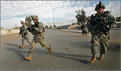 Soldiers from the 101st Airborne Division during a patrol in Bajii, Iraq, in December 2007. Three soldiers from the divison may have died from friendly fire, say military officials.