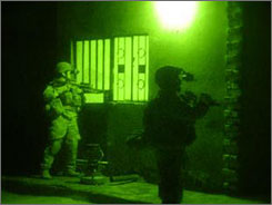 U.S. soldiers are seen through a night-vision lens as they surround a house last week in Muqdadiyah, Iraq. The raid was separate from one described by Army Rangers to USA TODAY.