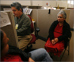 Ivan Zelaya, in the San Francisco eligibility unit, completes the final paperwork to sign up Juana Conejo, 63, for Health San Francisco. Conejo has no other insurance.