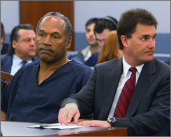 O.J. Simpson in court Wednesday in Las Vegas with his lawyer, Yale Galanter. An angry judge doubled Simpson's bail to $250,000 for attempting to contact a co-defendant in his armed robbery case.