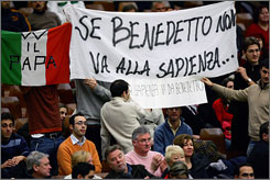 University students supporting Pope Benedict XVI hold a banner, reading &quot;If the Pope Doesn't Go to Sapienza (University) Sapienza Comes to the Pope,&quot; as the pope holds his general audience at the Vatican.  The pope canceled his trip to the university following protests and complaints from students and faculty that he devalues science.