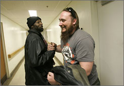 Iraq and Afghan war veteran Peter Mohan, right, visits a veterans homeless shelter, in Leeds, Mass. Vietnam veteran Robert Whitfield, left, is a Veterans Administration employee.