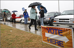 Voters turn out in the rain to cast their ballots in the South Carolina Republican presidential primary at Goose Creek High School in Goose Creek, S.C.