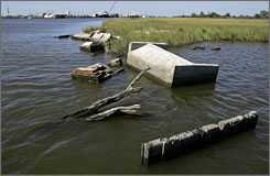 Tombs in Leeville, La. are now in the water, because of coastal erosion over the years.