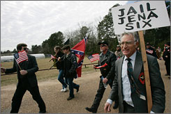 Members of the Nationalist Movement march in Jena, La., on Monday.