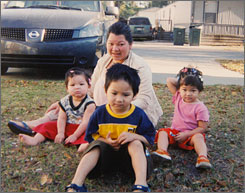 Undated photo of three of the four children police believe were tossed off an Alabama bridge to their deaths by their father. The three children, left to right, are Lindsey Luong, Ryan Phan and Hannah Luong, who authorities said Wednesday was the last of the four children found in the Gulf of Mexico. They are with their mother, Ngoc Phan.