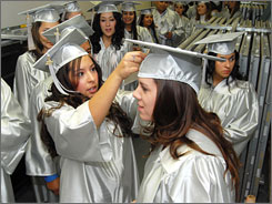 Eastern New Mexico University-Roswell students adjust each other's caps prior to Dec. 13 graduation ceremonies. Forget transcripts, multiple-choice tests or institutional scores. Surveyed business leaders want faculty assessment of graduates' internships, senior projects or community-based work.