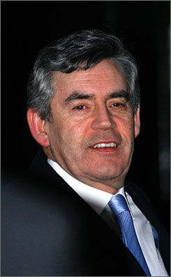 British Prime Minister Gordon Brown on Thursday as he left his residence on Downing Street in London. Brown has shuffled his cabinet and promoted younger lawmakers to higher positions.
