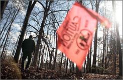 "U.S. Park Ranger Chuck Lochart walks by one of 467 ""dig holes"" created by artifact hunters near Heth's Salient Battle Site in Spotsylvania Courthouse Battlefield near Spotsylvania, Va."