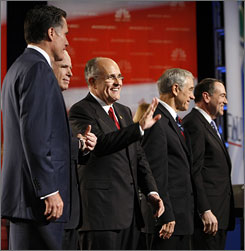 Republican hopefuls line up on stage prior to the start of their debate.