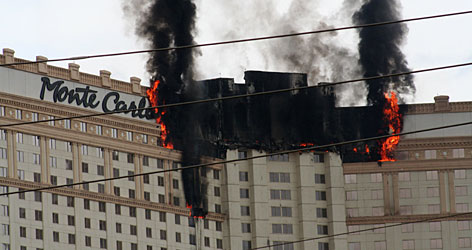 "Smoke and flames rise after a fire broke out at the Monte Carlo hotel-casino on Friday. Larry Wappel, 25, and his brother were in a room on the 30th floor of the 32-story hotel when they heard housekeeping staff banging on doors and yelling ""Fire, get out!"" He said it took about 10 minutes to walk single-file down the stairs to get to ground level."