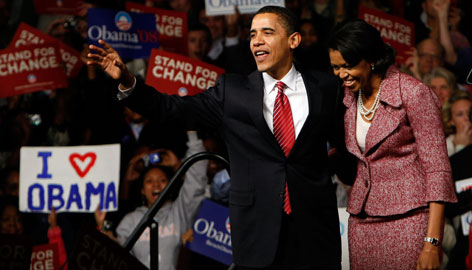 Barack Obama celebrates with his wife, Michelle, and supporters in Columbia, S.C., after convincingly winning the South Carolina primary Saturday. It is his first nominating contest victory since the kick-off Iowa caucus.
