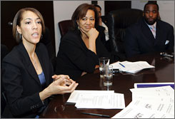 Christine Beatty, left, chief of staff to Detroit Mayor Kwame Kilpatrick, right, resigned Monday amid allegations of steamy text messages between the two. Both are seen here in an undated file photo. The woman in the middle is unidentified.