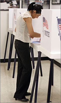 Sharon Gandhi votes early, on Jan. 22, in the California presidential primary in Norwalk, Calif. The state holds its presidential primary on Feb. 5.