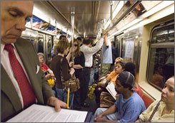 New Yorkers ride the subway in May 2007. The city's primary, slated for Super Tuesday on Feb. 5, has emerged as a crucial one.
