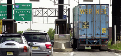 Cars and a truck go through tolls at Exit 8A of the New Jersey Turnpike in Monroe Township, N.J. Toll hikes are planned for most of the nation's signature toll roads, bridges and tunnels.