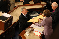 President Bush gives copies of his speech to Speaker Nancy Pelosi and Vice President Dick Cheney before beginning his final State of the Union speech.
