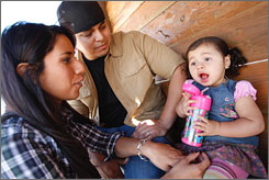 Melissa and Omar Melendez and their daughter, Lexie Jade Melendez, as she drinks from a stainless steel sippy cup during a visit to a family farm pumpkin patch in Lathrop, Calif., near their home. Since learning about bisphenal A, the family has used only BPA-free bottles and stainless steel sippy cups.