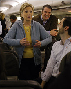 Democratic presidential candidate Hillary Cliinton talks to reporters on her campaign plane at the airport in Fort Lauderdale on Tuesday.