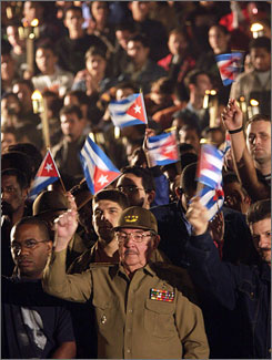 Raul Castro, Cuba's acting President and brother of Fidel Castro, leads a march of thousands of Cubans holding torches to celebrate the 155th anniversary of the birth of a Cuban national hero, Sunday. Raul bested his brother in Cuba's parliamentary vote, according to election results, Wednesday.