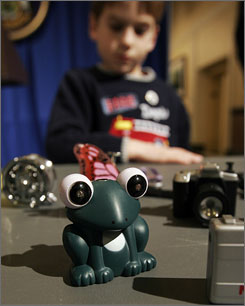 Shane St. Pierre, age 6, of Hartford, Maine, the son of a fire chief, looks over a display of lighters that resemble toys in Augusta, Maine, on Jan. 22, 2008. Many states are discussing bans for safety measures.