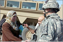 Bassima al-Jaidri, head of a committee that decides who can join the Iraqi police and army, meets with American officers.