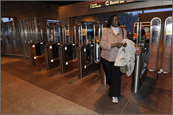 Lois Fletcher of Lithonia, Ga., at the Indian Creek Marta Station in Stone Mountain, Ga. Fletcher says she has lost weight from taking public transportation to her job in downtown Atlanta.
