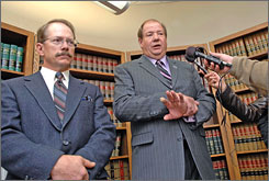 Farmers Wayne Hauge, left, and Dave Monson talk about their industrial hemp lawsuit during a news conference in Bismarck, N.D., on Nov. 14, 2007.