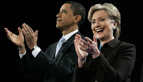 Democratic Sens. Barack Obama and Hillary Rodham Clinton applaud the crowd in the Kodak Theater prior to their debate in Los Angeles Jan. 31.