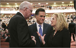 Mitt Romney, his wife Ann and Sen. Robert Bennett, R-Utah, attend the funeral of president Gordon B. Hinckley, leader of the Church of Jesus Christ of Latter-day Saints in Salt Lake City.