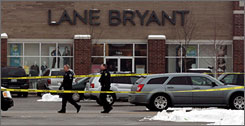Police investigate the shooting in a Lane Bryant store at the Brookside shopping center in Tinley Park, Ill., south of Chicago, Saturday.