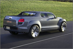 General Motors Corp.'s Denali XT concept is built on a car-like unibody frame, rather than a truck frame, for a smoother ride and better fuel economy. It's the first vehicle from GM that combines an ethanol-capable engine with the two-mode hybrid system.