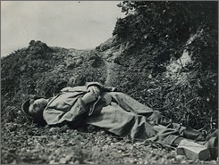 "This picture of Ernie Pyle's body, taken soon after he was killed by a Japanese bullet, was never released to the public. The man who took the picture, Army photographer Alexander Roberts, told a friend of Pyle's that the War Department withheld it ""out of deference"" to Pyle's ailing widow, Jerry."