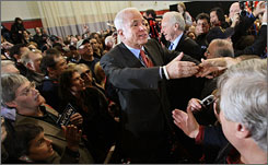 Republican presidential hopeful John McCain, senator from Arizona, greets supporters Sunday during a campaign stop at Sacred Heart University in Fairfield, Conn. He is joined by Sen. Joe Lieberman, I-Conn.