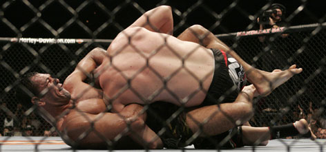 Brazilian fighter Antonio Rodrigo Nogueira locked in a guillotine choke that forced Tim Sylvia to submit in the third round of their heavyweight title fight on Saturday.