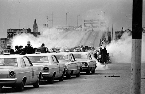 "Tear gas fumes fill the air on ""Bloody Sunday,"" March 7, 1965, as state troopers break up a demonstration march in Selma, Ala."